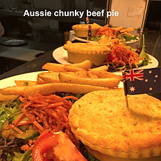 Aussie chunky beef pie served with salad and chips
