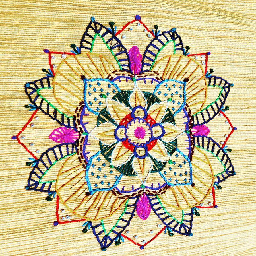 Detail of embroidery work on placemat pillows