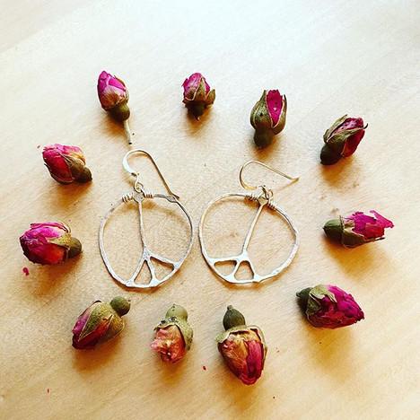 🌸🌹🌷Custom flower child earrings being
