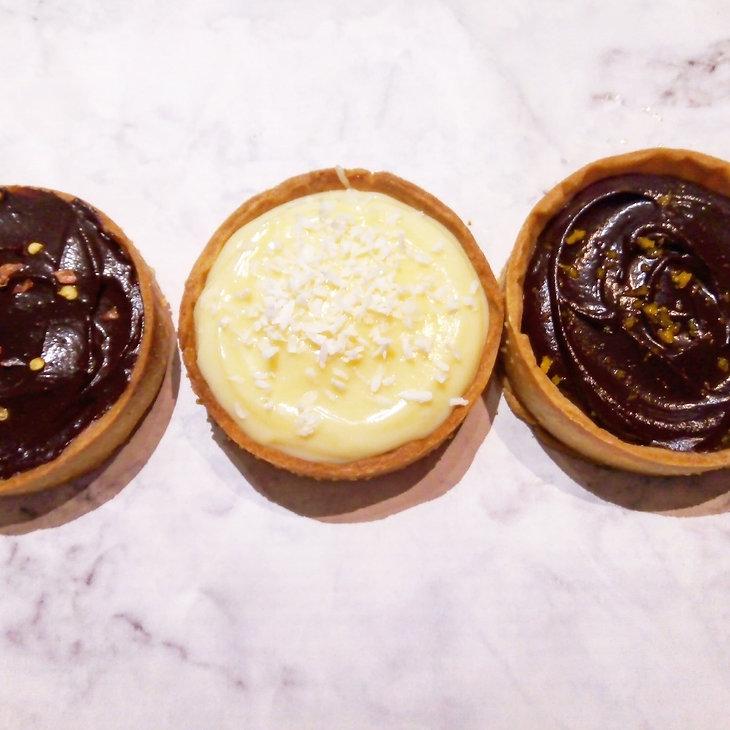 Trio of sweet chocolate tarts