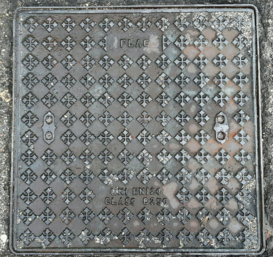 Assisi manhole cover