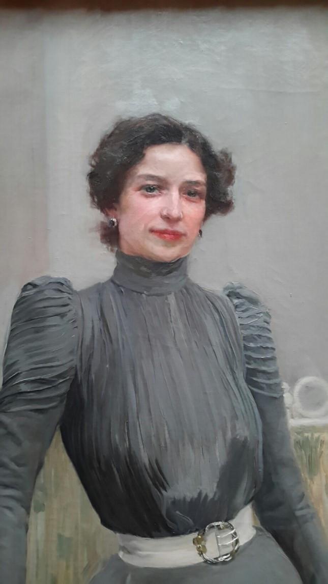Clotilde in a grey dress (1900)