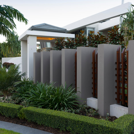 Fences don't have to be boring. We often combine materials for aesthetics and function.
