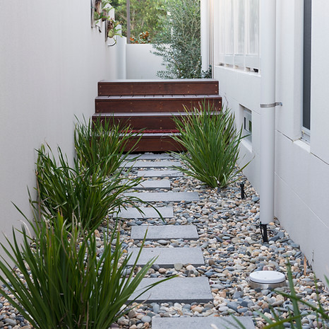 Good landscape design takes into account utility and access areas.