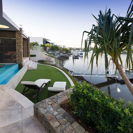 Clever terracing makes this backyard usable and nestles the home into its environment.