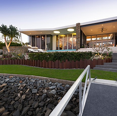 Landscaping connects this beautiful home with its waterfront environment.
