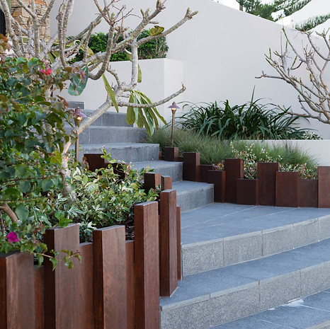 Combining materials, such as wood and stone, creates visual and textural interest.