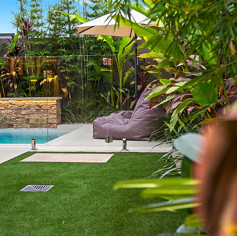 Artificial turf provides year-round green and never requires mowing.