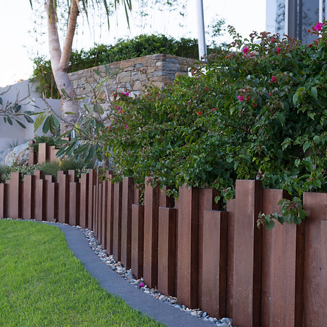 This timber retaining wall has a softening effect and blends easily with softscaping.