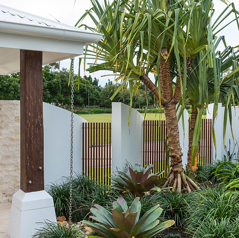 The fence is mindfully designed to incorporate solid and permeable elements.