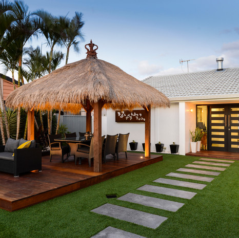 A deck and Bali pavilion creates the perfect casual entertaining area.