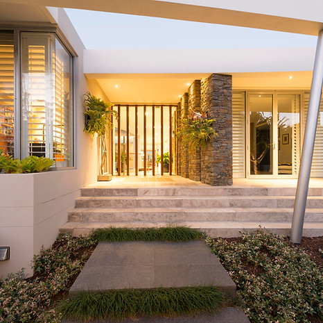 First impressions matter. Here we've created a verdant and welcoming entryway.