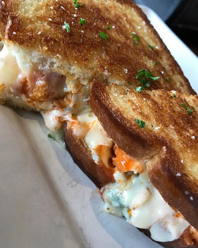 That buffalo brie bleu grilled cheese of the day will treat you good #jaxpicassos #grilledcheese #eatlocal