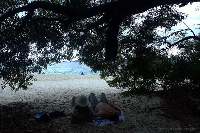 There's shaded areas among the trees on Whitehaven Beach where you can relax.