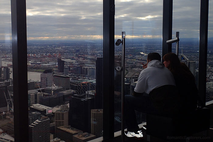 A couple enjoying Melbourne city views from Eureka Tower.