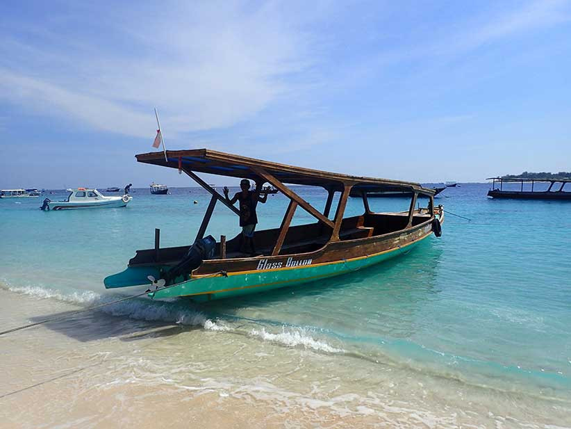 Looking for romantic things to do in Bali? Book a private glass bottom boat.