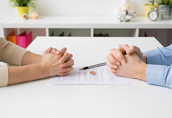 Couple going through divorce signing papers.jpg
