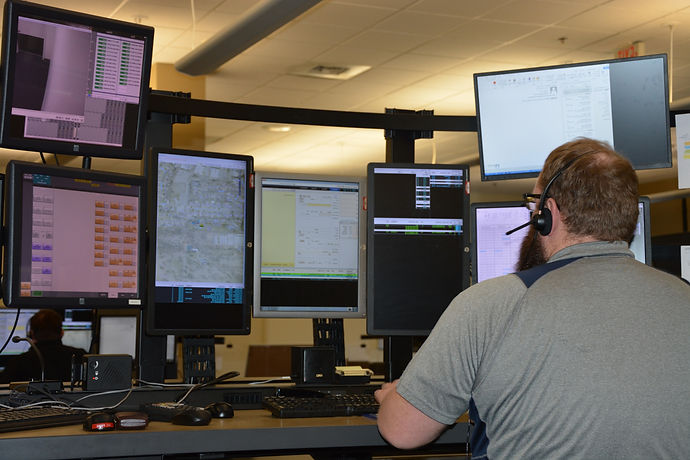 Dispatchers Answer Phone Calls in the Grand Rapids Police Dispatch Center
