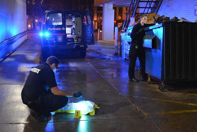 Crime Scene Technicians Investigating a Crime Scene