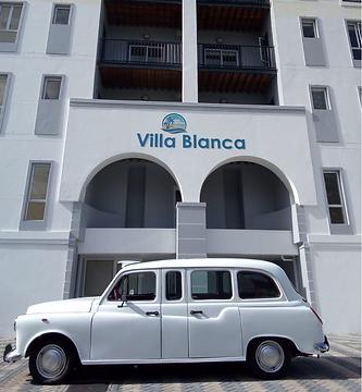 Villa Blanca Vintage Limo.png