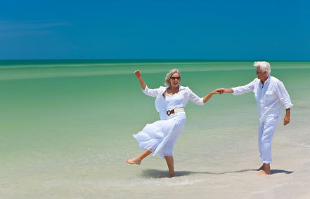 pensioner-couple-on-beach.jpg