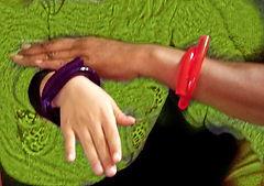 two bracelets on green.jpg