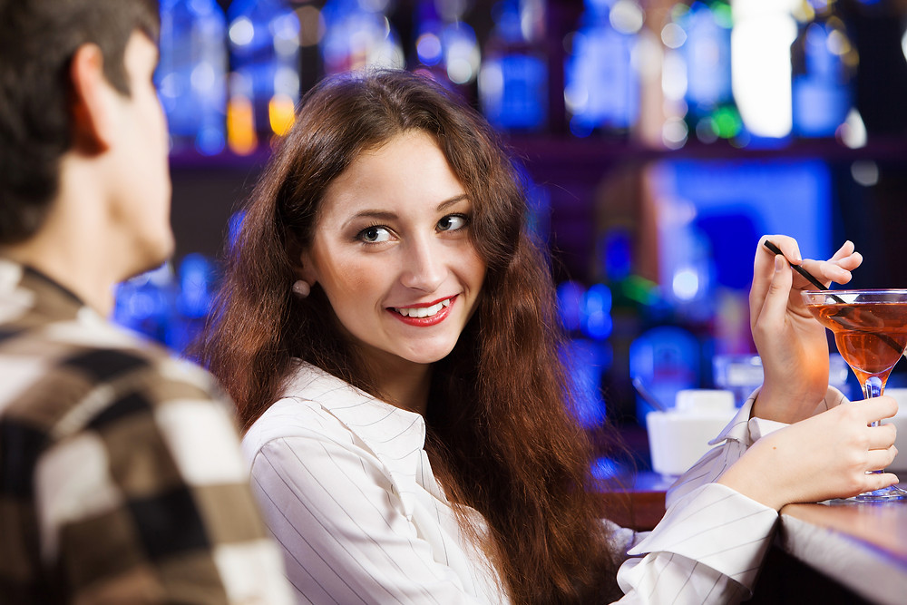 Woman looking at guy at Bar over shoulder.jpg