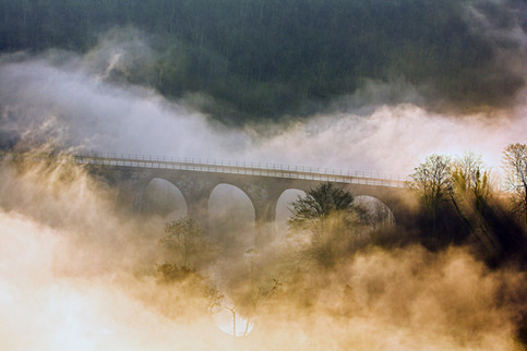 Monsalhead viaduct cloaked in thick mist