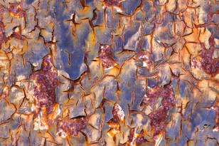 Abstract image of rust on a metal garage door