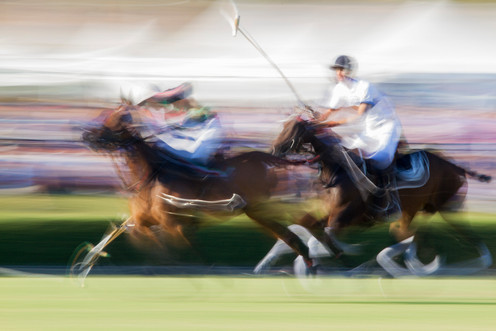 Abstract image of polo players in action
