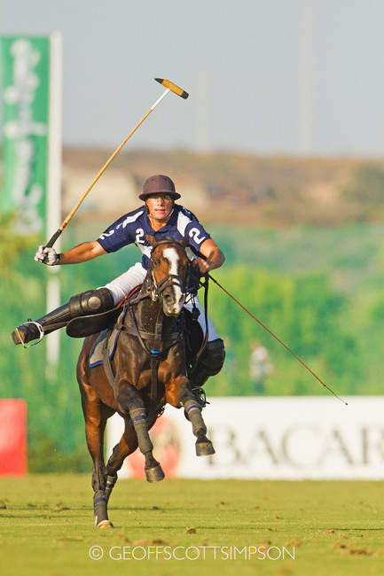 Polo player almost unsaddled