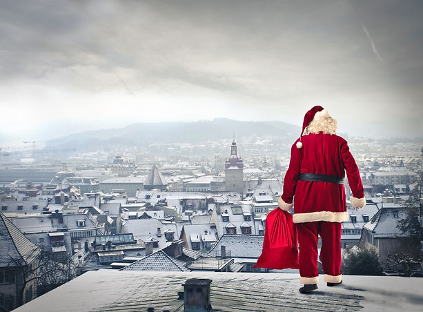 Santa Claus over the city with red sack.jpg