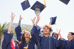 students tossing caps