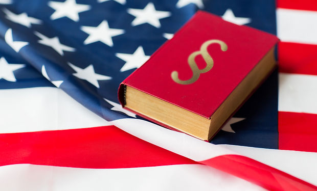 close-up-of-american-flag-and-lawbook-PE
