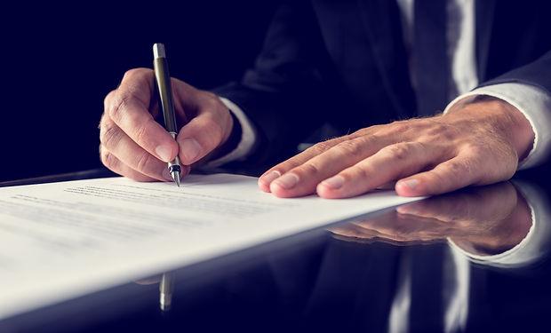signing-legal-document-PSE9PFT.jpg