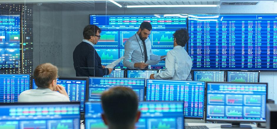 stock-traders-talking-business.jpg