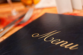 menu-on-a-restaurant-table-next-to-knife