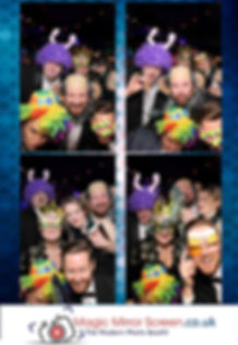 magic mirror photo print out with guests wearing wigs & props