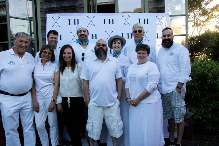 Birch community services team at the Daniel House croquet classic, cannon beach, Oregon  in front of step and repeat banner