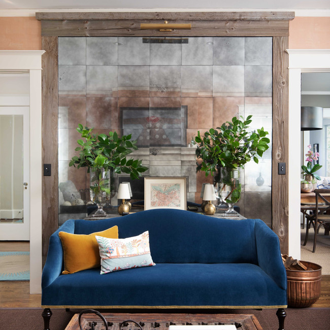 An antiqued mercury mirror tiled wall defines this space