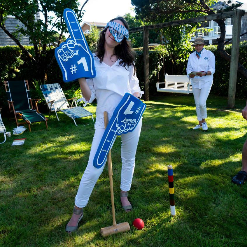 Anna shields in croquet whites at the Daniel House croquet classic in cannon beach oregon
