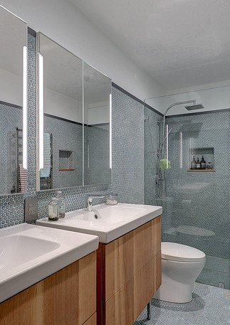 Tiling your walls can help make a bathroom look fresh and modern while still maintaining a timless feel.