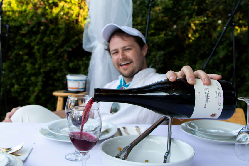 Alexander Spalding pours wine from Willamette Valley vineyards at the croquet classic from their Tualatin valley tasting rooms