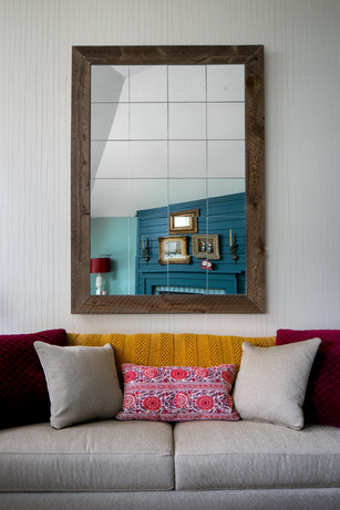 We like to make our own products. Like this mirror. Its actually a simple process. Attach mirror tile to plywood and frame it in a weather beaten frame.
