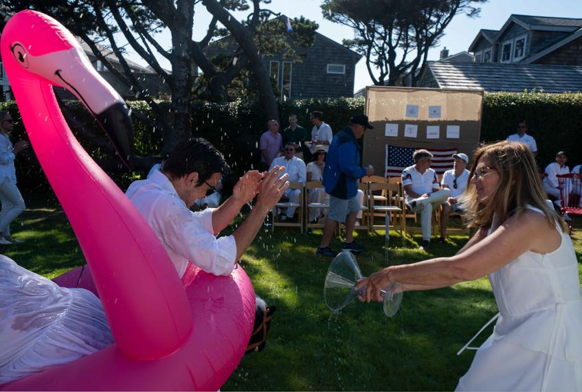 Martha Spalding soaks Kevin Fadden at the Daniel House croquet classic in cannon beach