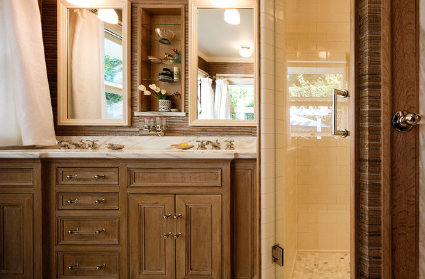 Marble, limed wood, and grasscloth help make this a bathroom you never want to leave