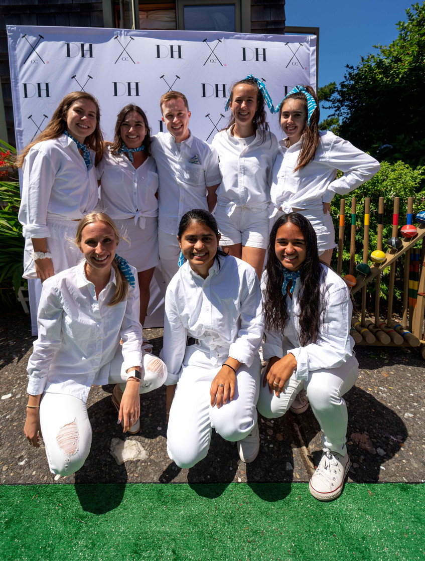 everybody athletics volunteers at the Daniel House croquet classic, wearing croquet whites