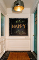 A chalkboard at your front door is a great way welcome guests