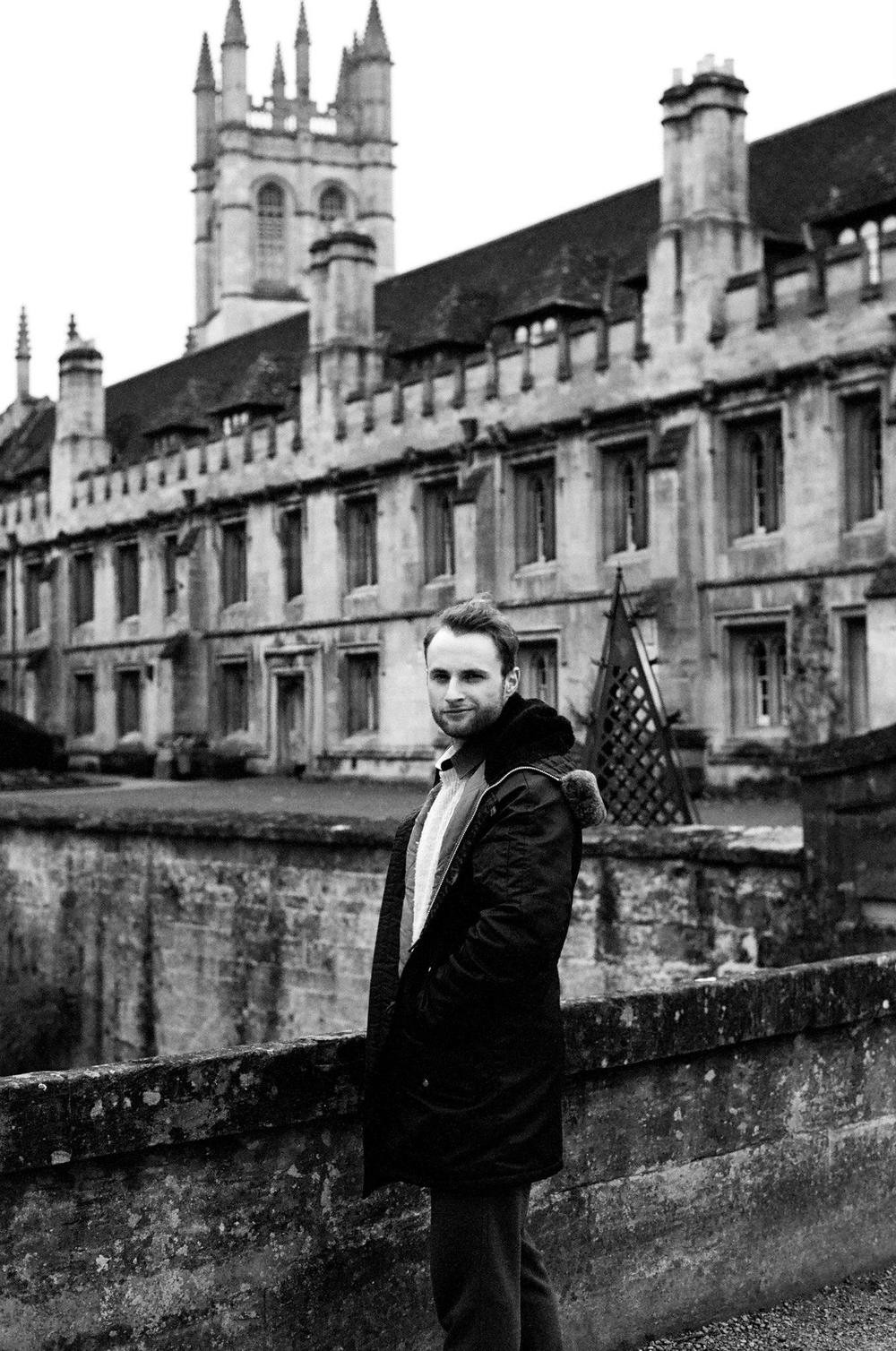 Peter Spalding, Daniel House's Director of Design, standing in front of Magdalen College, Oxford, classical architecture, medieval building, collegiate architecture, magdalen tower