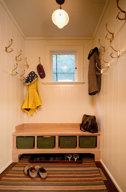 Here we covered a coat closet in wood and built in a bench to make a space that you actually want show off rather than close off